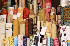 Fabric rolls at a street market. Fabric rolls on sale at a street market in england royalty free stock images