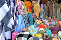 Fabric on rool for sale at the  textiles market Royalty Free Stock Photography