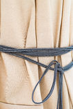 Fabric with a rope Royalty Free Stock Image