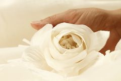 Fabric rose. Hand of craftman shows a fabric rose stock image