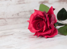 Fabric rose on wooden background Royalty Free Stock Images