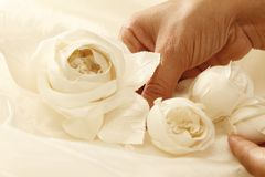 Fabric roses. A craftsman working on a wedding dress royalty free stock photography
