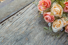 fabric roses,Fake textile vintage on wood background Royalty Free Stock Images