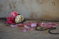 Fabric roses on tabel. Photo of roses hand made, table, pinck color, beads, wood, background wallpaper Stock Photo