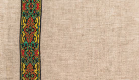 The fabric is a rough linen, with colored vertical band. Stock Images