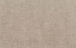 The fabric is rough linen. Rough fabric, flax, grunge background royalty free stock photo