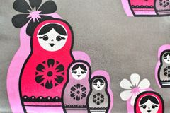 Fabric with Russian doll motif Stock Images