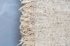 Fabric sackcloth texture on a gray background.Burlap texture. Pattern  fabric textile. Royalty Free Stock Images