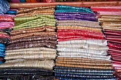 Fabric for sale. Bolts of fabic all piled up for sale Royalty Free Stock Photography