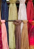 Fabric for sale. Bolts of fabic or scarves hanging for sale Royalty Free Stock Images