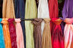 Fabric for sale. Bolts of fabic or scarves hanging for sale Stock Photo