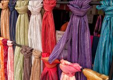 Fabric for sale. Bolts of fabic or scarves hanging for sale Royalty Free Stock Image