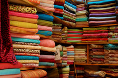 Fabric for sale in Morocco. A market stall with various fabric for clothing Royalty Free Stock Images