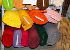 Fabric for sale on the shelves of haberdashery. Colorful fabric rolls for sale on the shelves of haberdashery Stock Images