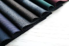 Fabric samples on background. Fabric samples on wooden background Royalty Free Stock Image