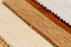 Fabric samples. Closeup detail of multi color fabric samples texture background Royalty Free Stock Photo