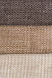 Fabric samples. Closeup detail of multi color fabric samples texture background Royalty Free Stock Images