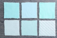 Fabric samples on background. Fabric samples on grey background Royalty Free Stock Images
