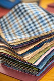 Fabric samples. Or swatches of various textiles for garment making in a tailors shop or seamstress showing an assortment of colors and textures Royalty Free Stock Photo