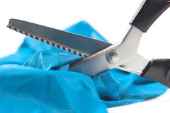 Fabric Scissors. Cutting blue cloth Stock Photo