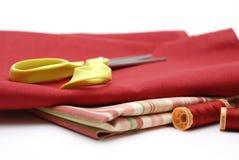 Fabric with Scissors. Red Fabric with Scissors and Thread Stock Photo