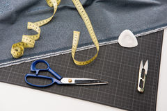 Fabric, scissors and measuring tape for dressmaking Stock Photos
