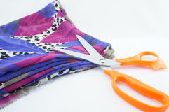 Fabric and scissors. New fabric colours for a beautiful tailor with sharp scissors Royalty Free Stock Photo