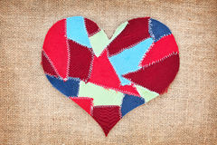 Fabric scraps heart. On texture grunge background. Valentine's Day Royalty Free Stock Photography