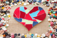 Fabric scraps heart. On texture background. Valentine's Day. Buttons frame Stock Photos