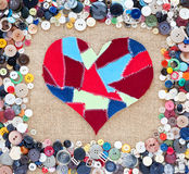 Fabric scraps heart. Buttons frame Stock Image