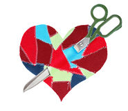 Fabric scraps heart with scissors. Isolated on white background Royalty Free Stock Photo
