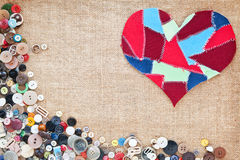 Fabric scraps heart on texture background. Buttons frame Royalty Free Stock Image