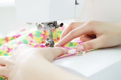 Fabric in a sewing machine Royalty Free Stock Photography