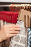 Fabric shop. Woman's hands checking the material quality of some fabric royalty free stock photography