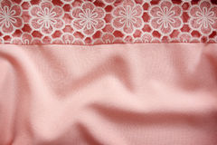 Fabric silk pink-beige pale lace background Royalty Free Stock Photos