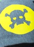 Fabric with skulls. Fabric with skulls and bones Stock Photo