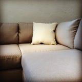 Fabric sofa with cushion Stock Photo