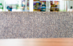 Fabric sofa and wooden table in shop.  Stock Photography