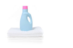 Fabric Softener Detergent Container. Sitting on a White Folded Towel With Copy Space Royalty Free Stock Photos