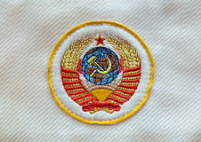 Fabric soviet USSR emblem with hammer and sickle Royalty Free Stock Photography