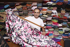 Fabric Store Owner Working At Counter Royalty Free Stock Photos