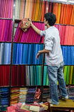 Fabric Store Seller. Fabric store in one of the markets of Kathmandu, Nepal Stock Photo