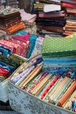 Fabric store with stacks of colorful textiles royalty free stock images