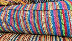 Fabric Store, Traditional fabric store with stacks of colorful textiles, fabric rolls at market stall - textile industry. Stock Photo