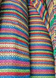 Fabric Store, Traditional fabric store with stacks of colorful textiles, fabric rolls at market stall - textile industry. Royalty Free Stock Photo