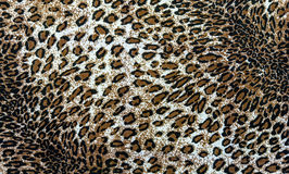Fabric on striped leopard. The fabric on striped leopard on background Stock Photo