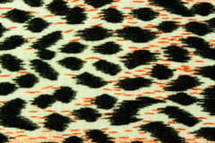 The fabric on striped leopard for background. Used as raw material for screen and print pattern royalty free stock photography