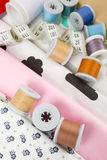 Fabric, tailor measurement tape and thread spools Royalty Free Stock Photo