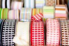 Fabric tapes reels in haberdashery of vichy Stock Photos