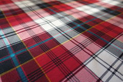 Fabric with tartan plaid pattern in red, black, white Royalty Free Stock Photo